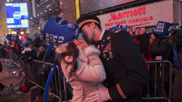 National Guardsman John Cebak (R) kisses his fiancee Sonja Babic at the start of the new year in Times Square in New York January 1, 2013. Photo by Reuters
