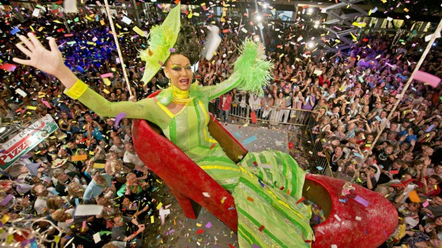 Gary Marion, portraying female impersonator Sushi, hangs in an oversized replica of a women's red high heel over Duval Street, late Monday night, December 31, 2012 in Florida. Photo by AFP