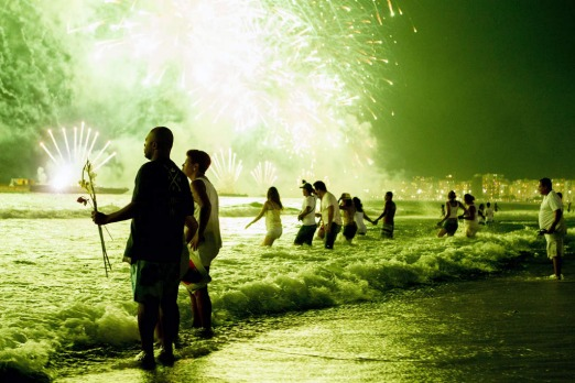People watch fireworks along Copacabana Beach in Rio de Janeiro on January 1, 2013, during celebrations by over three million people attending New Year's Eve festivities.  Photo by AFP