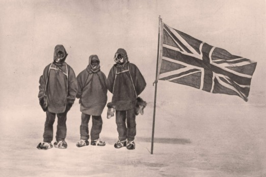 Sir Ernest Henry Shackleton and two members of his expedition team beside a Union Jack within 111 miles of the South ...