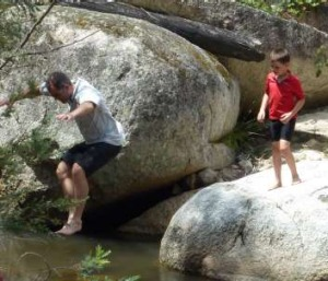 Dad! Andrew Freebairn shows his son Oliver the way to cool-off in the Tidbinbilla River after a ride