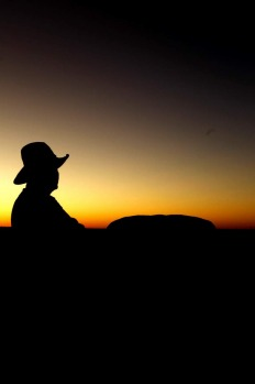 Sunrise at World Heritage listed Uluru in Australia's Northern Territory with Chris Hill from  Uluru Camel Tours.