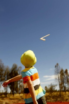 World Heritage listed Uluru in Australia's Northern Territory. Boomerang  throwing as part of the Voyages free daily ...