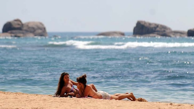 Hot spot ... tourists take a rest on the beach of Sri Lanka's southern coastal town of Hikkaduwa.