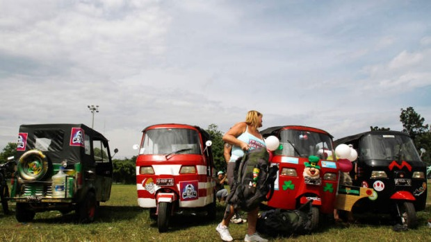 "A participant of the ""Bajai rally""  prepares before setting off."
