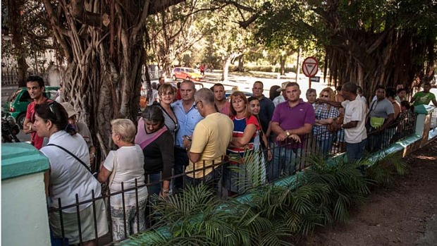 Passport applicants ... Cubans queue outside a Migration Office.