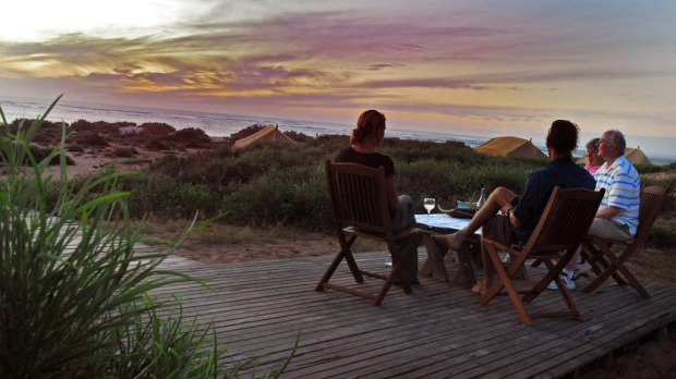 NINGALOO REEF. Go for: Camaraderie with visitors from around the world at a luxe beach camp. Stay for: Turtles, whale sharks and epic marine life. Caption: Sal Salis beach camp at Ningaloo.