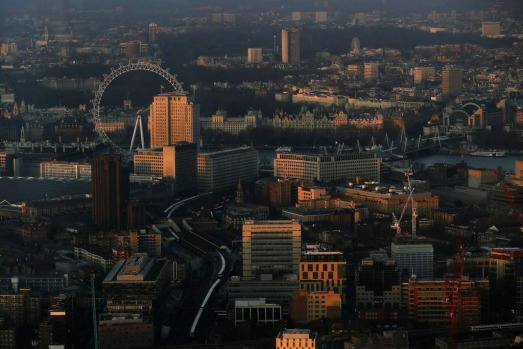The early morning sun lights buildings in an aerial photograph from The View gallery at the Shard, western Europe's ...