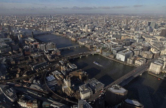 St. Paul's Cathedral, center, is seen beyond the River Thames from 'The View From The Shard', a series of viewing ...