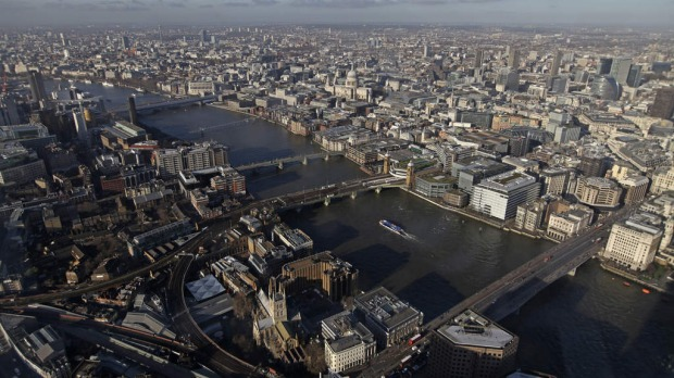 St. Paul's Cathedral, center, is seen beyond the River Thames from 'The View From The Shard', a series of viewing galleries near the top of the Shard tower in London.