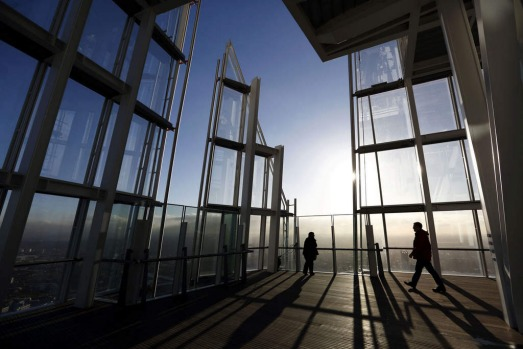 "People admiring the view of London from the 68th floor of ""The Shard"" in central London. The 310-metre Shard has been ..."