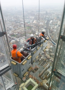 "A construction team carries out checks on the exterior of the 68th floor of ""The Shard"" in central London.  Designed by ..."