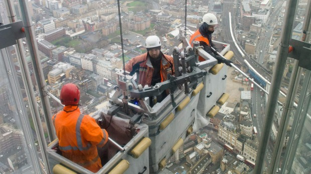 "A construction team carries out checks on the exterior of the 68th floor of ""The Shard"" in central London.  Designed by Italian architect Renzo Piano The Shard, which is the tallest building in the European Union, stands at 309.6 meters high."