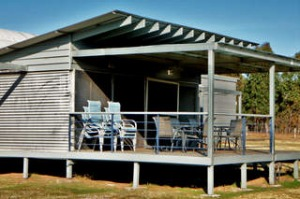 IronBark Hill Lodge sleeps 15 people and includes use of a swimming pool and tennis court.