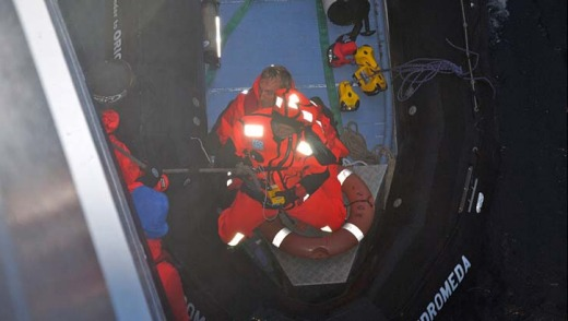 Gotchya ... Alain Delord is winched aboard the MV Orion.