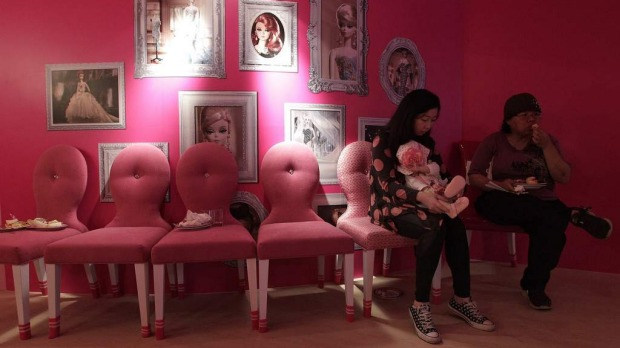 Customers eat dessert during the media preview of the Barbie-themed cafe in Taipei. The 660-square-metre Barbie Cafe, fashioned with Mattel's barbie doll-themed decor and food dishes, is in Taipei's Zhongxiao Dunhua shopping belt.