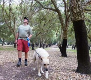 Ben Roberts and his dog Ralph enjoy a stroll through the historic cork oak plantation