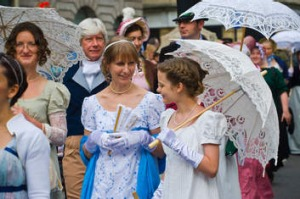 Jane Austen Festival ... ladies in Regency costume promenade through Bath. Photo: Alamy