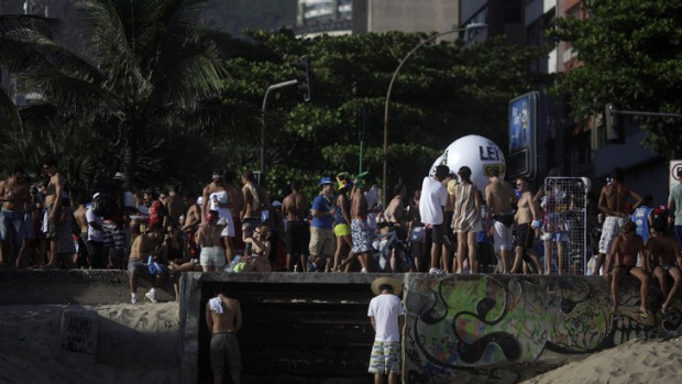 "Men urinate during the annual block party known as the ""Simpatia e Quase Amor"" during pre-carnival celebrations in Rio de Janeiro February 2, 2013."