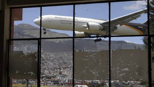 Hairy landing ... a plane approaches the Mariscal Sucre airport, seen from a nearby school.
