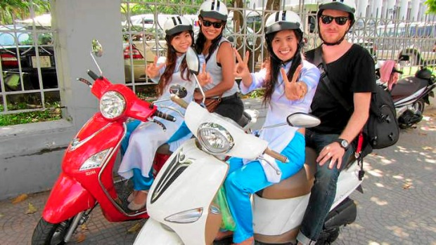 Scootin' ... the XO Tours group in Ho Chi Minh City.