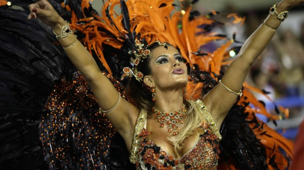 Drum queen Lucilene Caetano, from Inocentes de Belford Roxo samba school, dances during a carnival parade at the Sambadrome.