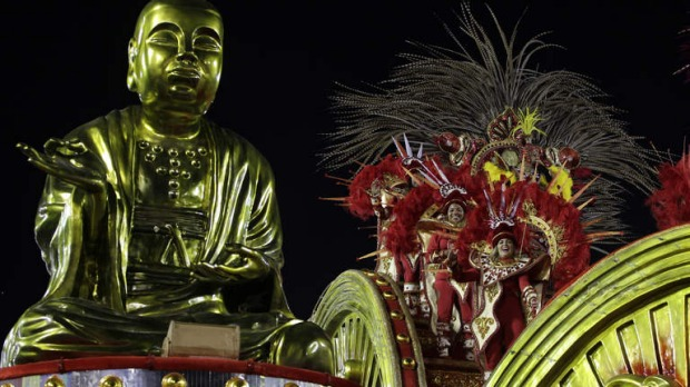 Dancers perform atop a float during Inocentes de Belford Roxo;s samba school parade at the Sambadrome.