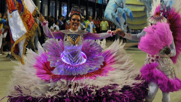 A reveller of the Inocentes de Belford-Roxo samba school performs during the first night of Carnival parade at the Sambadrome in Rio de Janeiro.