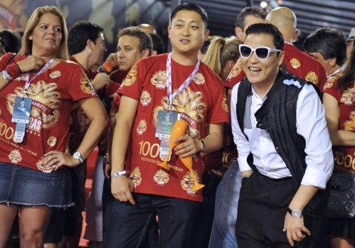 "South Korean singer Psy (R) smiles at the Sambadrome. The creator of the song ""Gangnam style"" is in Rio on a two-day ..."
