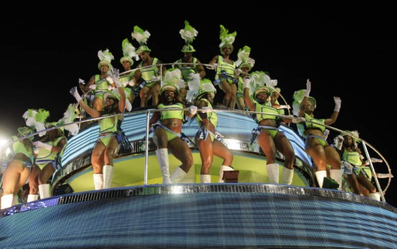 Dancers perform atop a float during the Inocentes de Belford Roxo samba school parade in Rio de Janeiro.