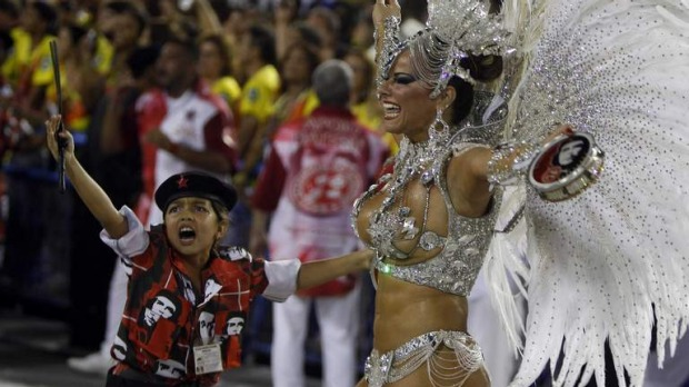 Drum Queen Viviane Araujo (R) of the Salgueiro samba school participates on the first night of the annual Carnival parade in Rio de Janeiro's Sambadrome.