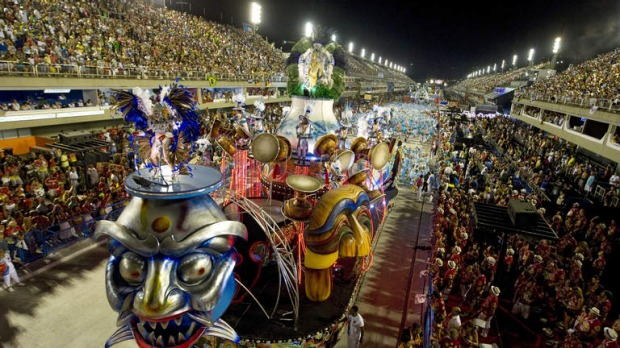 Revellers of the Inocentes de Belford-Roxo samba school perform during the first night of Carnival parade at the Sambadrome in Rio de Janeiro.