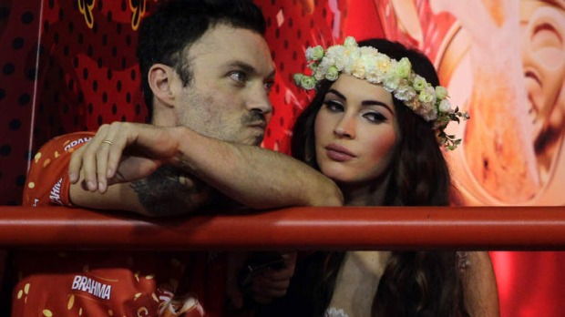 US actress Megan Fox, right, and her husband Brian Austin Green attend the Carnival parades at the Sambadrome in Rio de Janeiro.