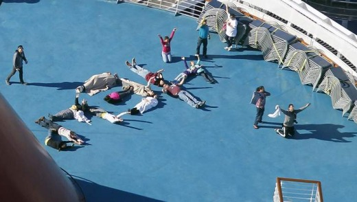 "Passengers spell out the word ""HELP"" aboard the disabled Carnival Lines cruise ship Triumph as it is towed to harbour ..."