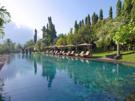 Jungle hills and rice paddies surround the  25-metre pool at the Chedi Club outside Ubud, Bali.