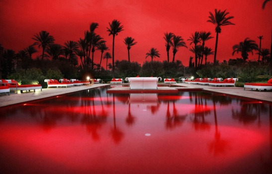 Set among hibiscus and bougainvillea, the red-tile pool is especially striking at night, when red lights add a extra ...