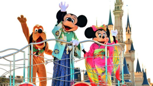 East meets West ... Mickey and Minnie Mouse in kimonos, with Pluto, at Tokyo Disneyland.