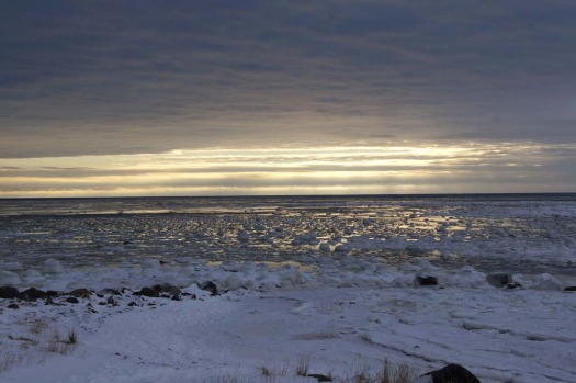 The sun breaks through the clouds on Hudson Bay near Seal River Lodge, north of Churchill, Manitoba.