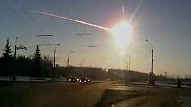 Caught on camera ... the meteor streaks through the sky over Chelyabinsk, Russia.