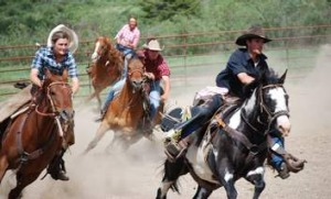 In the saddle ... wranglers on the chase at Paradise Ranch.