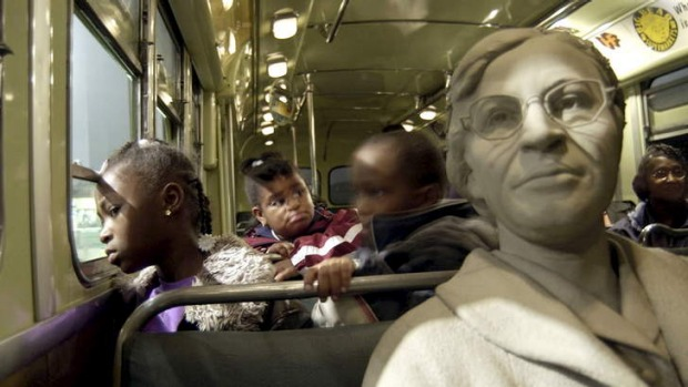 Strength and courage ... visitors with a statue of Rosa Parks on a replica bus at the museum in Montgomery that honours ...