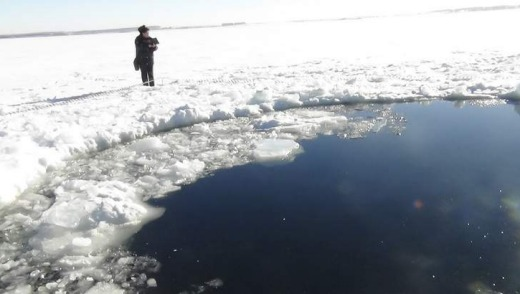 A Russian policeman works near an ice hole, said by the Interior Ministry department for Chelyabinsk region to be the ...