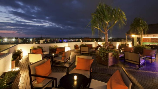 Sunset vista ... the cool, contemporary aesthetic of the Luna Rooftop Restaurant and Bar at L Hotel.