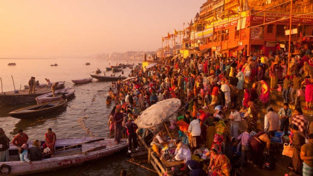 Holy dedication: pilgrims on the Ganges in Varanasi.