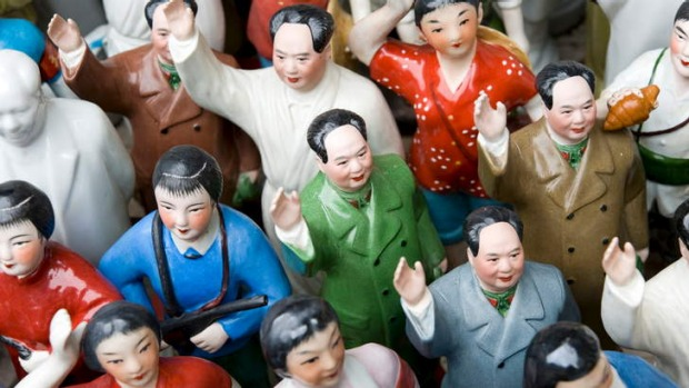 Chairman Mao and other Cultural Revolution ceramic figures on a stall at Dongtai Road Antiques Market, Shanghai.