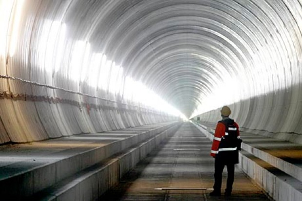 THE LONGEST RAILWAY TUNNEL IN THE WORLD: A visitor stands at the Erstfeld-Amsteg section of the NEAT Gotthard Base ...