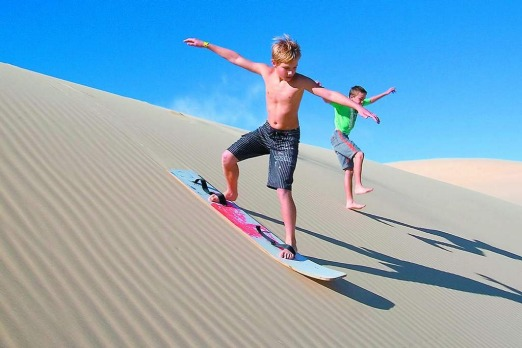 Sandboarding on the Stockton Dunes, Port Stephens. The experience: Sandboarding and four-wheel-driving in the dunes. ...
