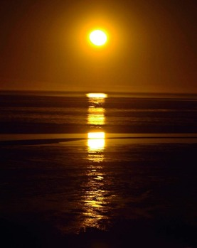 View from Town Beach of the Staircase to the Moon phenomenon, which happens across Roebuck Bay, Broome, WA. The ...