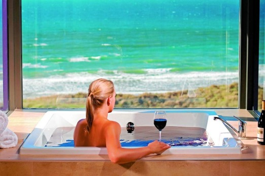 The experience: Chardonnay body scrub, pinot bath and a glass of wine. Snuggled in the wild dunes of Tasmania?s far