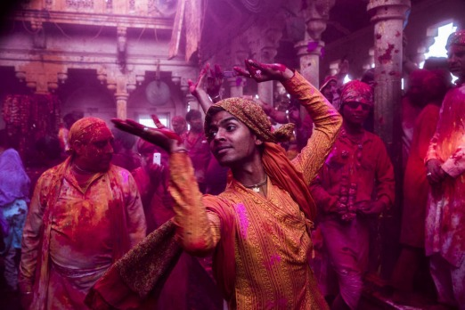 Hindu devotees play with colour in the village of Barsana, India.